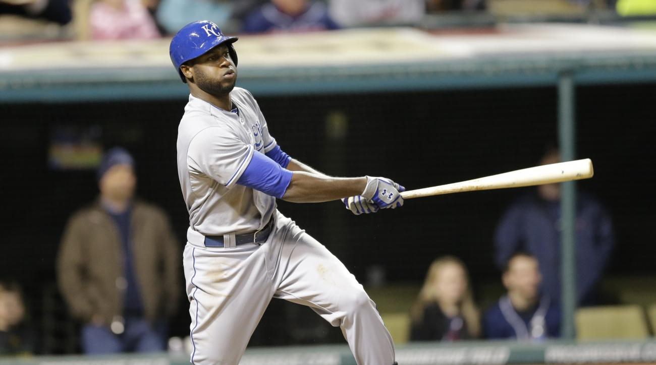 Kansas City Royals' Lorenzo Cain hits a single off Cleveland Indians starting pitcher Corey Kluber in the seventh inning of a baseball game, Monday, April 27, 2015, in Cleveland. (AP Photo/Tony Dejak)