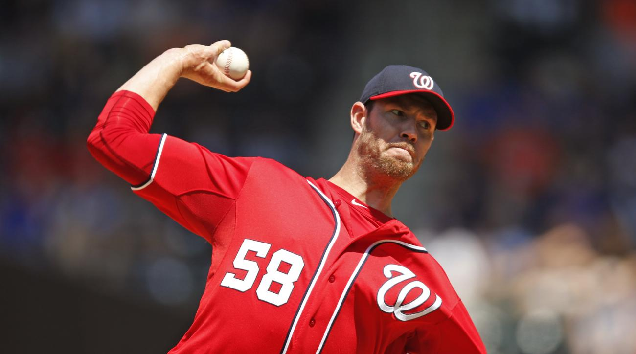 Washington Nationals starting pitcher Doug Fister delivers in the second inning of a baseball game against the New York Mets in New York, Sunday, May 3, 2015. (AP Photo/Kathy Willens)