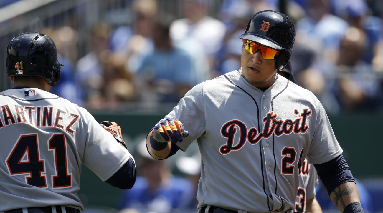 Detroit Tigers' Miguel Cabrera (24) is congratulated by teammate Victor Martinez (41) after his two-run home run off Kansas City Royals starting pitcher Jeremy Guthrie during the fifth inning of a baseball game at Kauffman Stadium in Kansas City, Mo., Sun