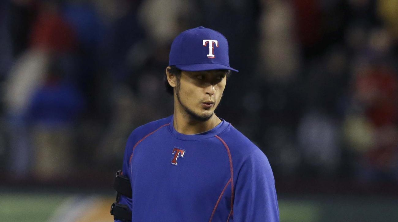 Texas Rangers pitcher Yu Darvish of Japan walks onto the field after a baseball game against the Los Angeles Angels in Arlington, Texas, Tuesday, April 14, 2015. (AP Photo/LM Otero)