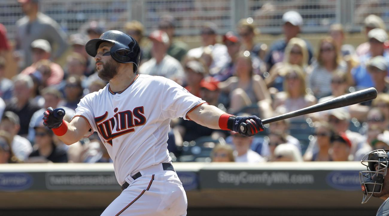 Minnesota Twins' Trevor Plouffe watches the flight of his grand slam off Chicago White Sox starting pitcher John Danks during the third inning a baseball game in Minneapolis, Sunday, May 3, 2015. (AP Photo/Ann Heisenfelt)