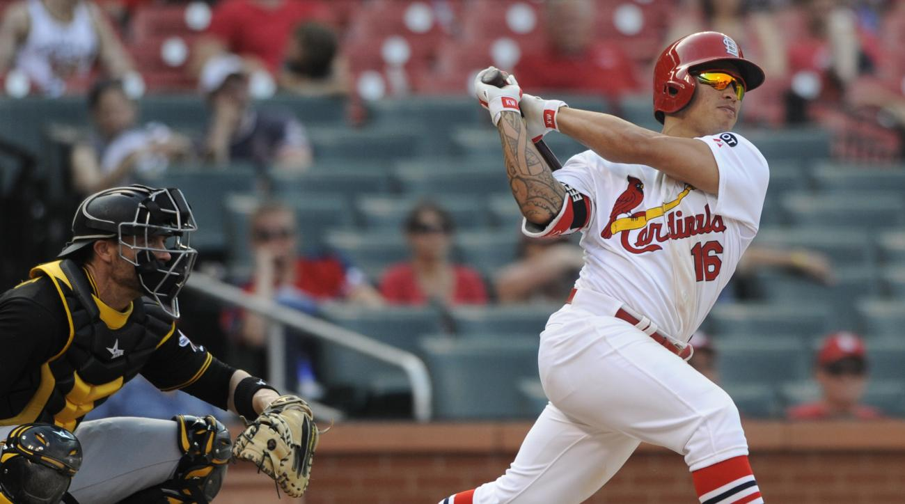 St. Louis Cardinals' Kolten Wong (16) follows through on his walk-off home run as Pittsburgh Pirates' Chris Stewart, left, looks on in the fourteenth inning in a baseball game, Sunday, May 3, 2015, at Busch Stadium in St. Louis. The Cardinals won 3-2. (AP