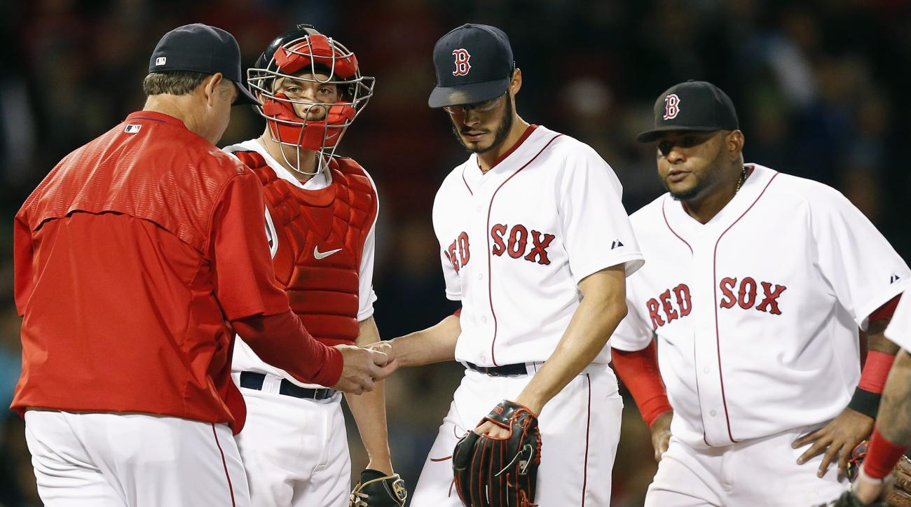 Boston Red Sox's Blake Swihart, second from left, and Pablo Sandoval, right watch as starting pitcher Joe Kelly, center, hands the ball to manager John Farrell, left, as Kelly is taken out during the fifth inning of a baseball game against the New York Ya