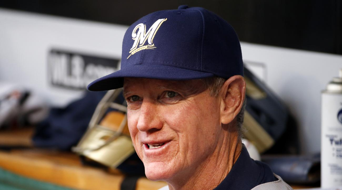 Milwaukee Brewers manager Ron Roenicke sits in the dugout before a baseball game against the Pittsburgh Pirates in Pittsburgh, Saturday, April 18, 2015. (AP Photo/Gene J. Puskar)