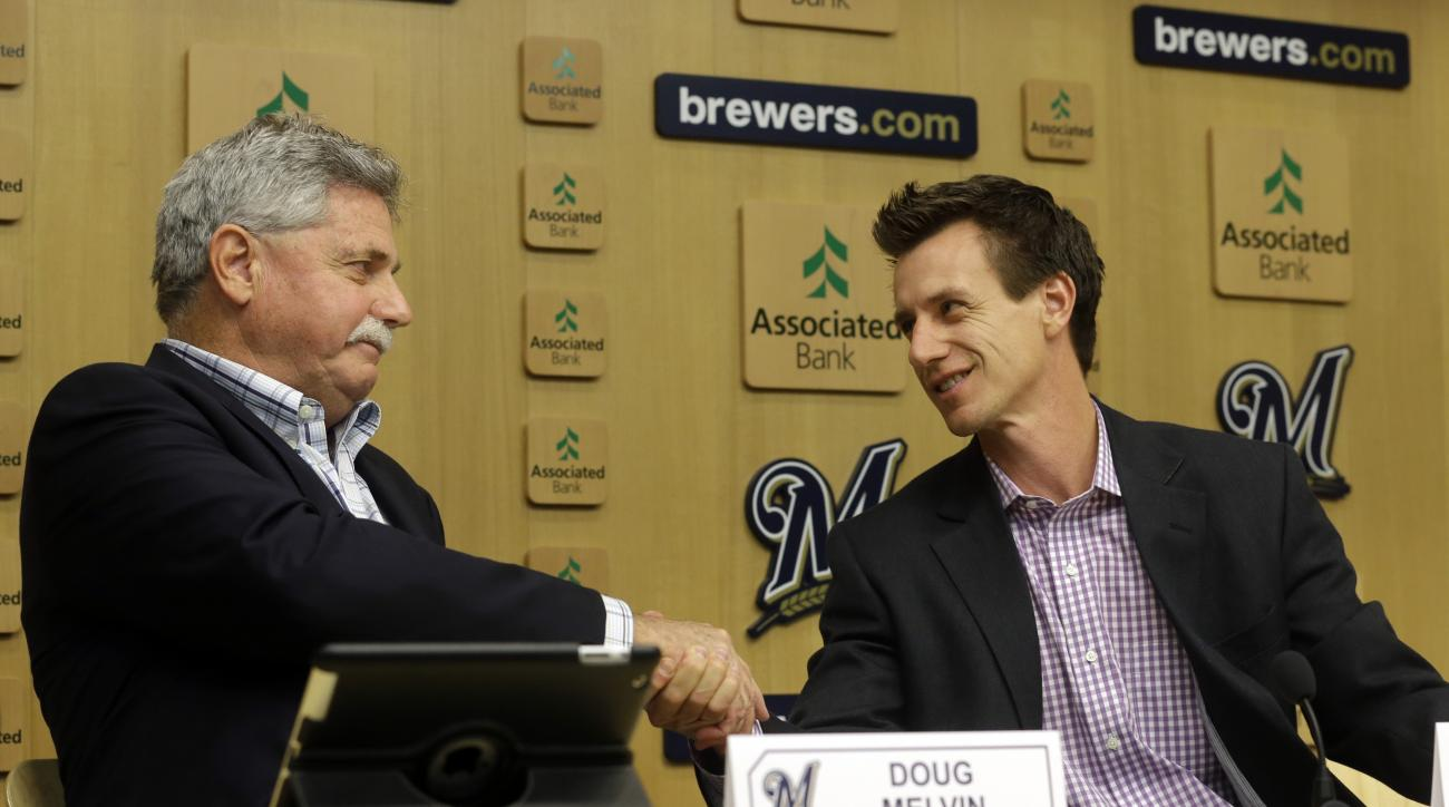 Milwaukee Brewers new manager Craig Counsell shakes hands with general manager Doug Melvin at a baseball news conference Monday, May 4, 2015, in Milwaukee. Counsell replaces manager Ron Roenicke who was fired on Sunday. (AP Photo/Morry Gash)