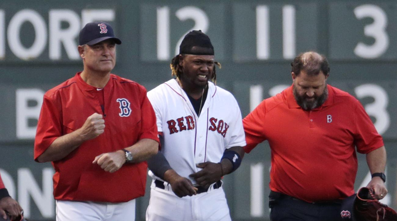 Boston Red Sox left fielder Hanley Ramirez is helped from the field by manager John Farrell, left, and trainer Rick Jameyson during the first inning of a baseball game against the Tampa Bay Rays at Fenway Park in Boston, Monday, May 4, 2015. Ramirez left
