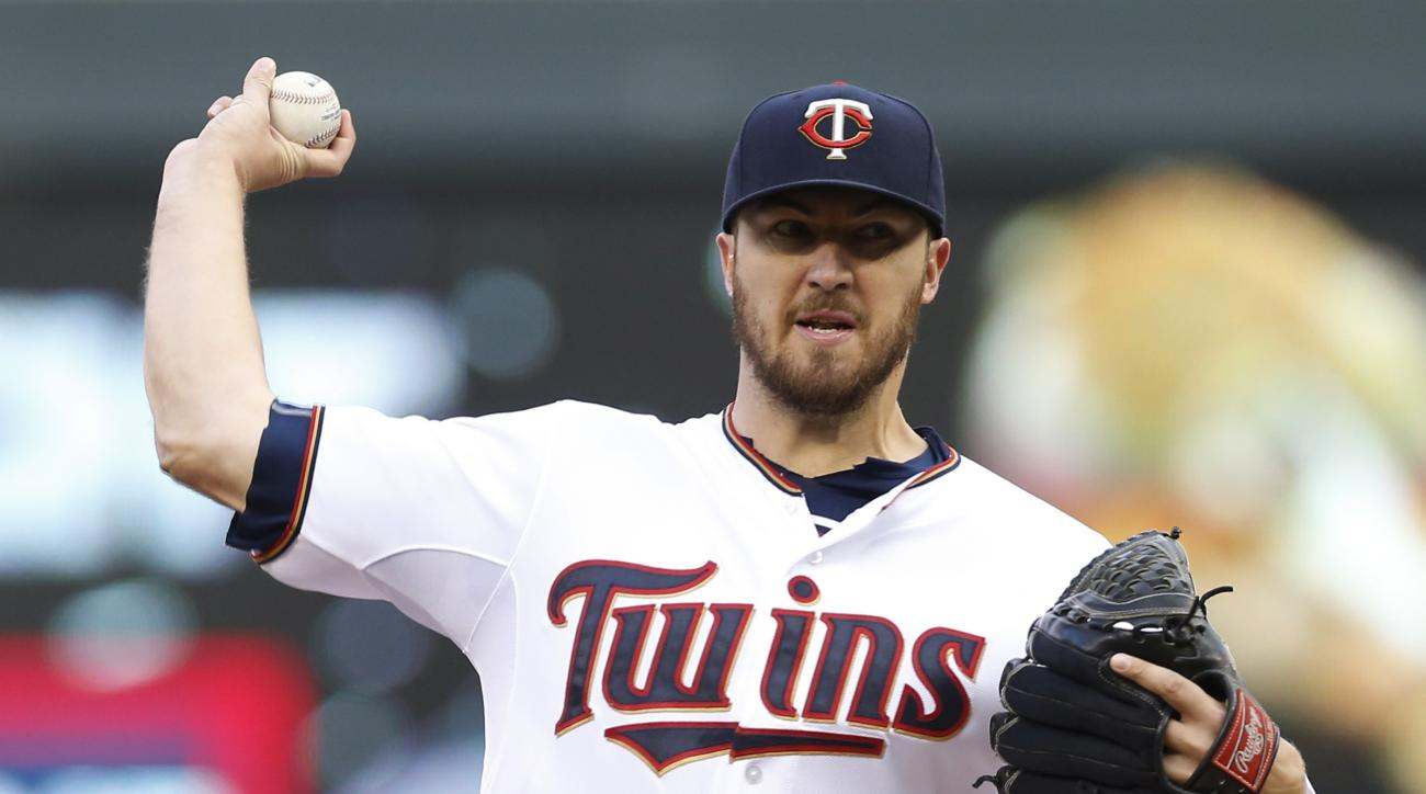 Minnesota Twins pitcher Phil Hughes throws against the Oakland Athletics in the first inning of a baseball game Monday, May 4, 2015, in Minneapolis. (AP Photo/Jim Mone)