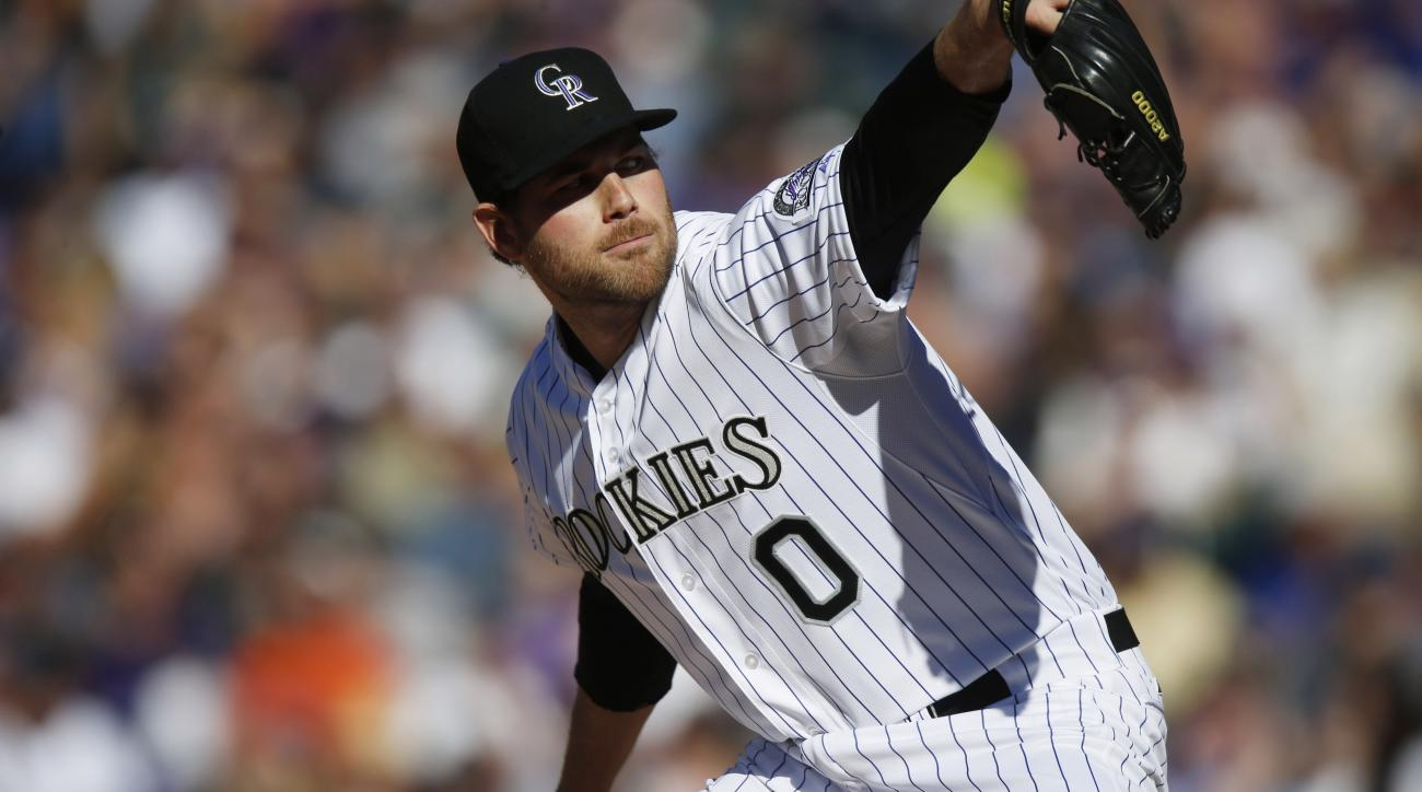 In this Sunday, April 12, 2015, photo, Colorado Rockies relief pitcher Adam Ottavino works against the Chicago Cubs in the eighth inning of a baseball game in Denver. Ottavino said Monday a recent MRI revealed a partial ulnar collateral ligament tear in h