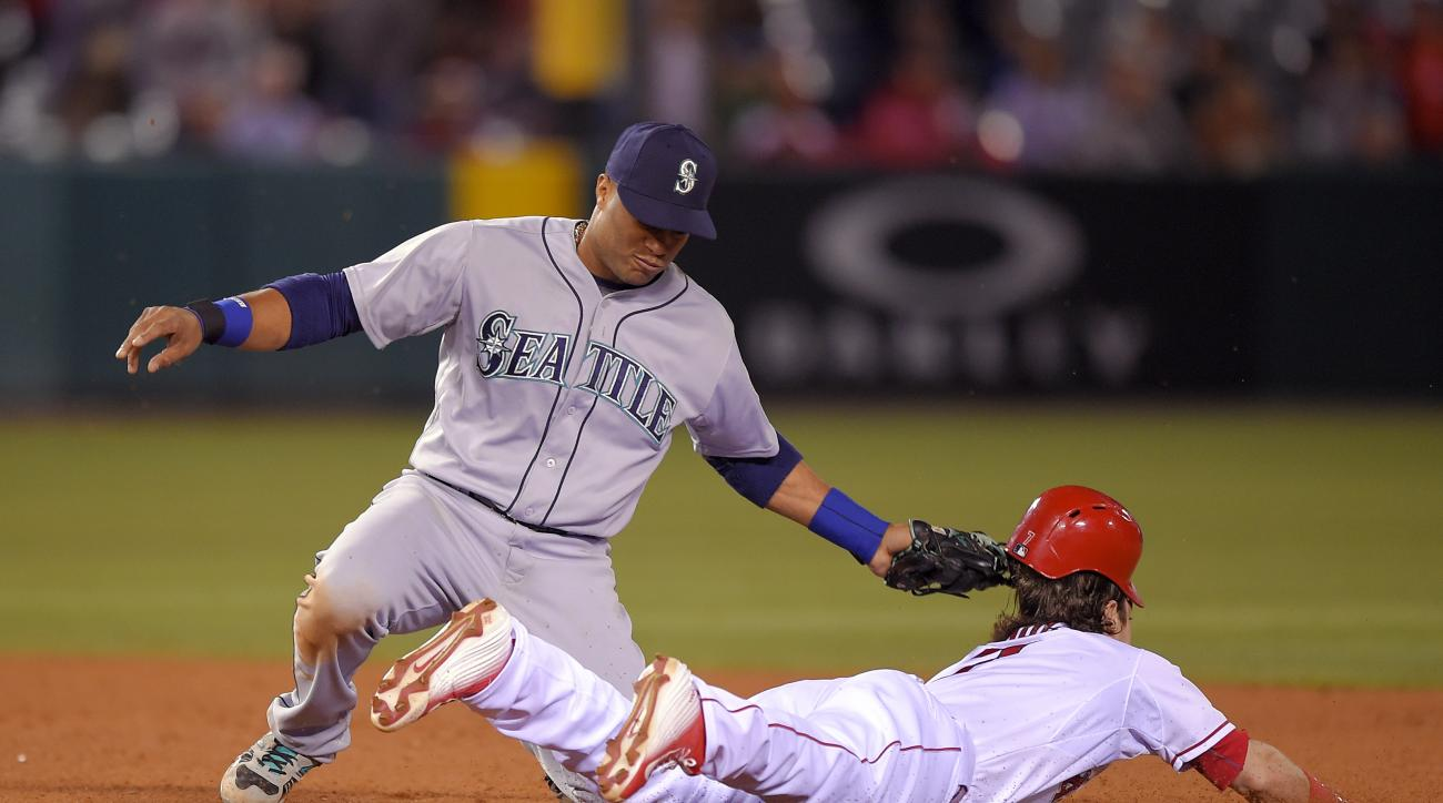 Seattle Mariners second baseman Robinson Cano tags out Los Angeles Angels' Collin Cowgill to end the game as Cowgill tries to steal second during the ninth inning of a baseball game, Monday, May 4, 2015, in Anaheim, Calif. (AP Photo/Mark J. Terrill)