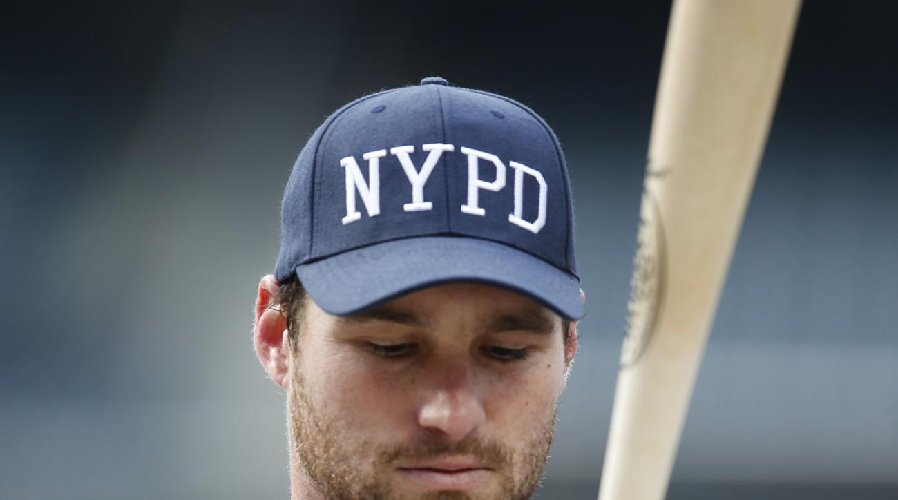 New York Mets Daniel Murphy adjusts his grip on a bat during batting practice before a baseball game against the Baltimore Orioles in New York, Tuesday, May 5, 2015. Players wore New York Police Department hats during batting practice in memory of slain N