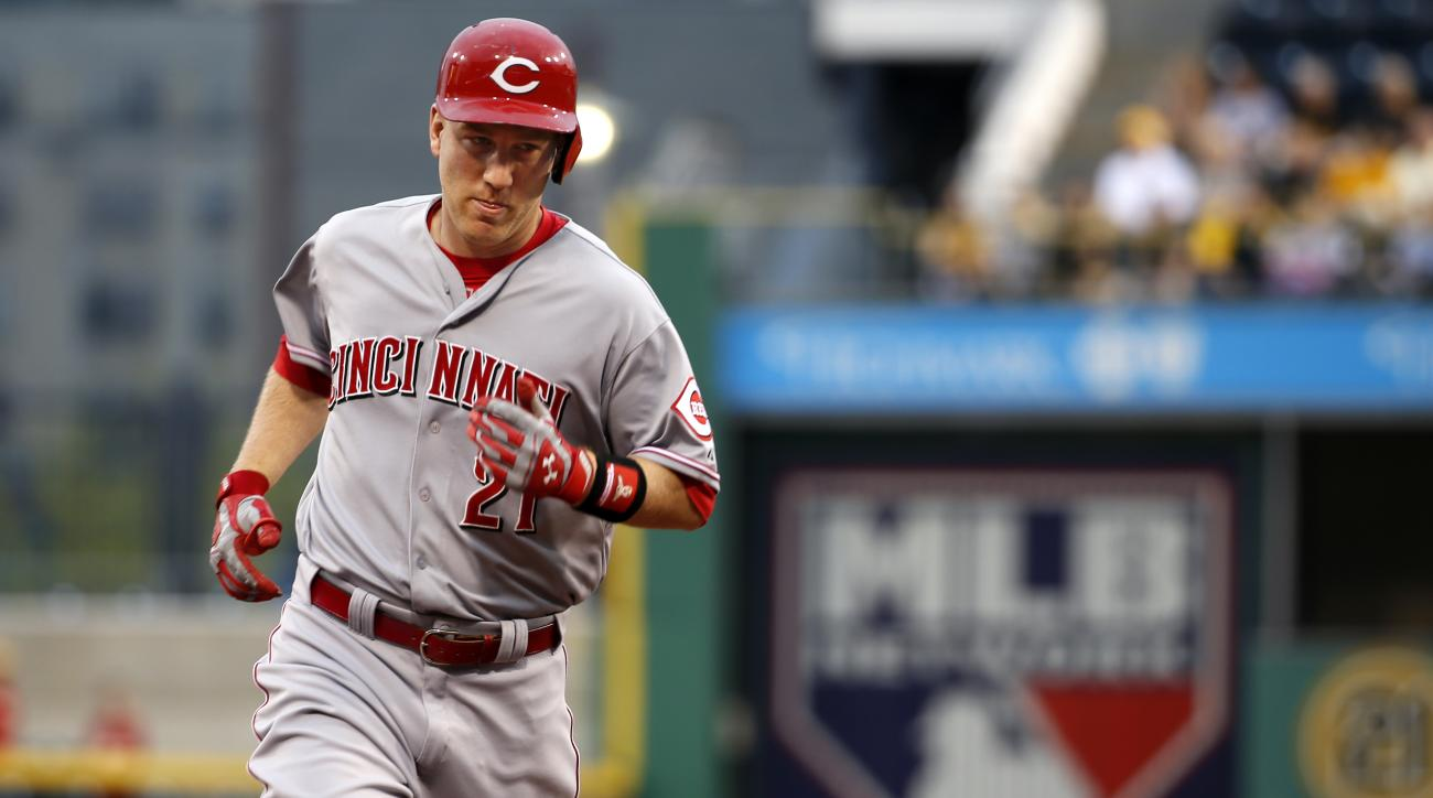 Cincinnati Reds' Todd Frazier (21) rounds second after hitting a solo-home run off Pittsburgh Pirates starting pitcher Jeff Locke in the second inning of a baseball game in Pittsburgh, Tuesday, May 5, 2015. (AP Photo/Gene J. Puskar)