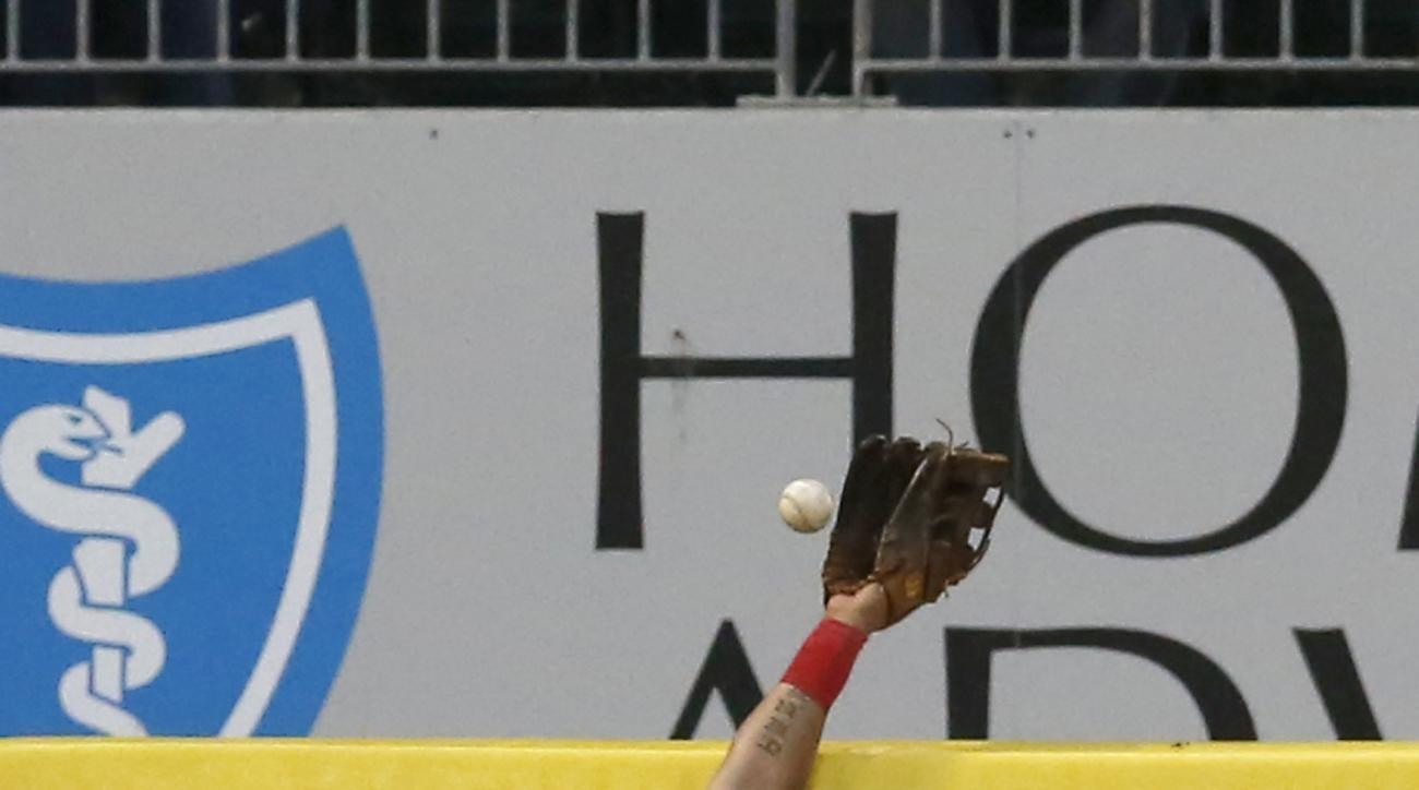 Chicago White Sox left fielder Melky Cabrera is unable to catch Detroit Tigers' Alex Avila's home run during the second inning of a baseball game Tuesday, May 5, 2015, in Chicago. (AP Photo/Charles Rex Arbogast)