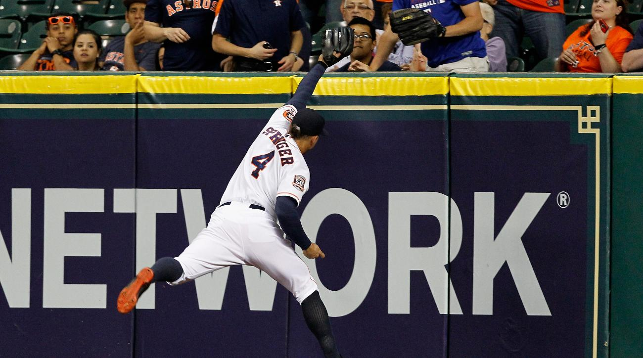 Houston Astros right fielder George Springer (4) makes a running catch on a fly ball hit Texas Rangers'  Adrian Beltre in the seventh inning in a baseball game Tuesday May 5, 2015, in Houston. (AP Photo/Bob Levey)