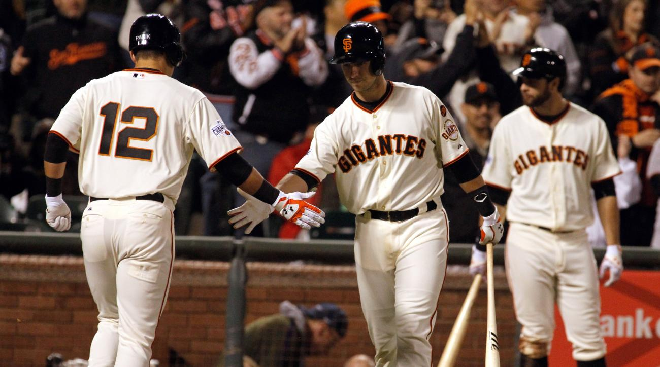 San Francisco Giants' Joe Panik (12) is congratulated by Buster Posey after his solo home run against the San Diego Padres during the fifth inning of a baseball game Tuesday, May 5, 2015, in San Francisco. (AP Photo/Mathew Sumner)