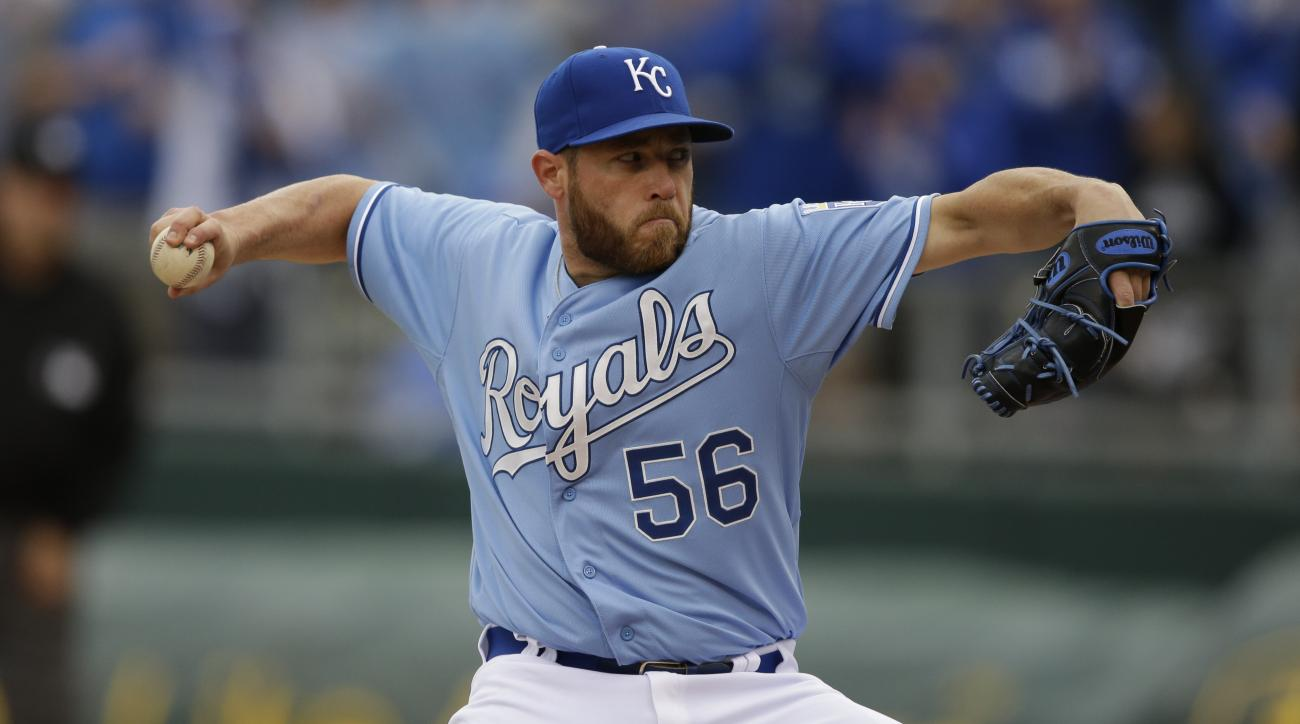 Kansas City Royals relief pitcher Greg Holland (56) during a baseball game against the Chicago White Sox at Kauffman Stadium in Kansas City, Mo., Thursday, April 9, 2015. The Royals defeated the White Sox 4-1. (AP Photo/Orlin Wagner)