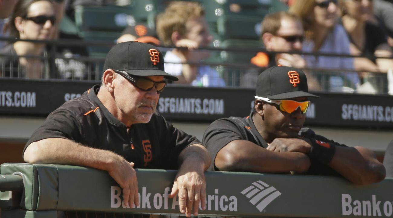 San Francisco Giants manager Bruce Bochy, left, and hitting coach Hensley Meulens, right, stand at the top of the dugout in the ninth inning of their baseball game against the San Diego Padres Wednesday, May 6, 2015, in San Francisco. San Diego won the ga