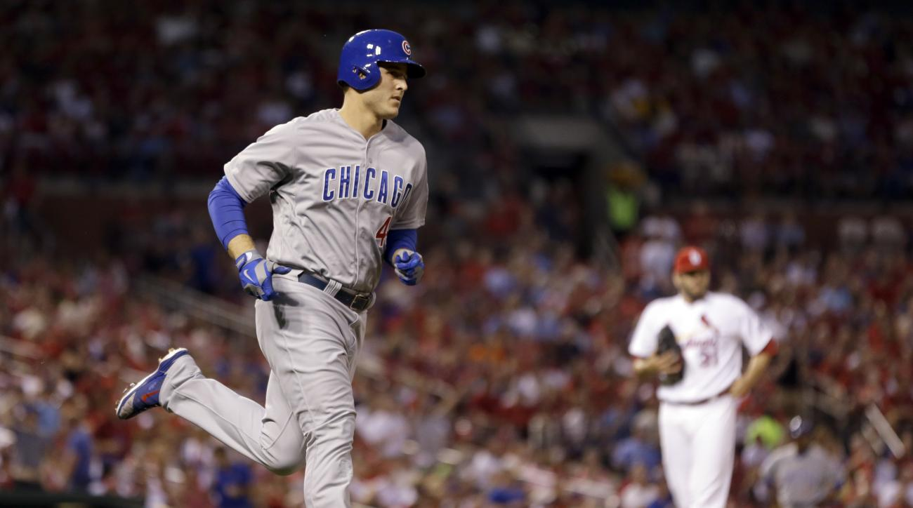 Chicago Cubs' Anthony Rizzo, left, rounds the bases after hitting a solo home run off St. Louis Cardinals starting pitcher Lance Lynn, right, during the third inning of a baseball game Wednesday, May 6, 2015, in St. Louis. (AP Photo/Jeff Roberson)