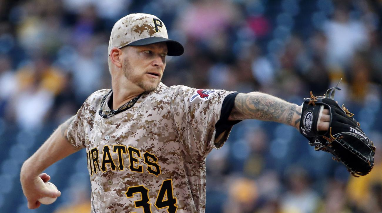 Pittsburgh Pirates starting pitcher A.J. Burnett throws in the first inning of a baseball game against the Cincinnati Reds in Pittsburgh, Thursday, May 7, 2015. (AP Photo/Gene J. Puskar)