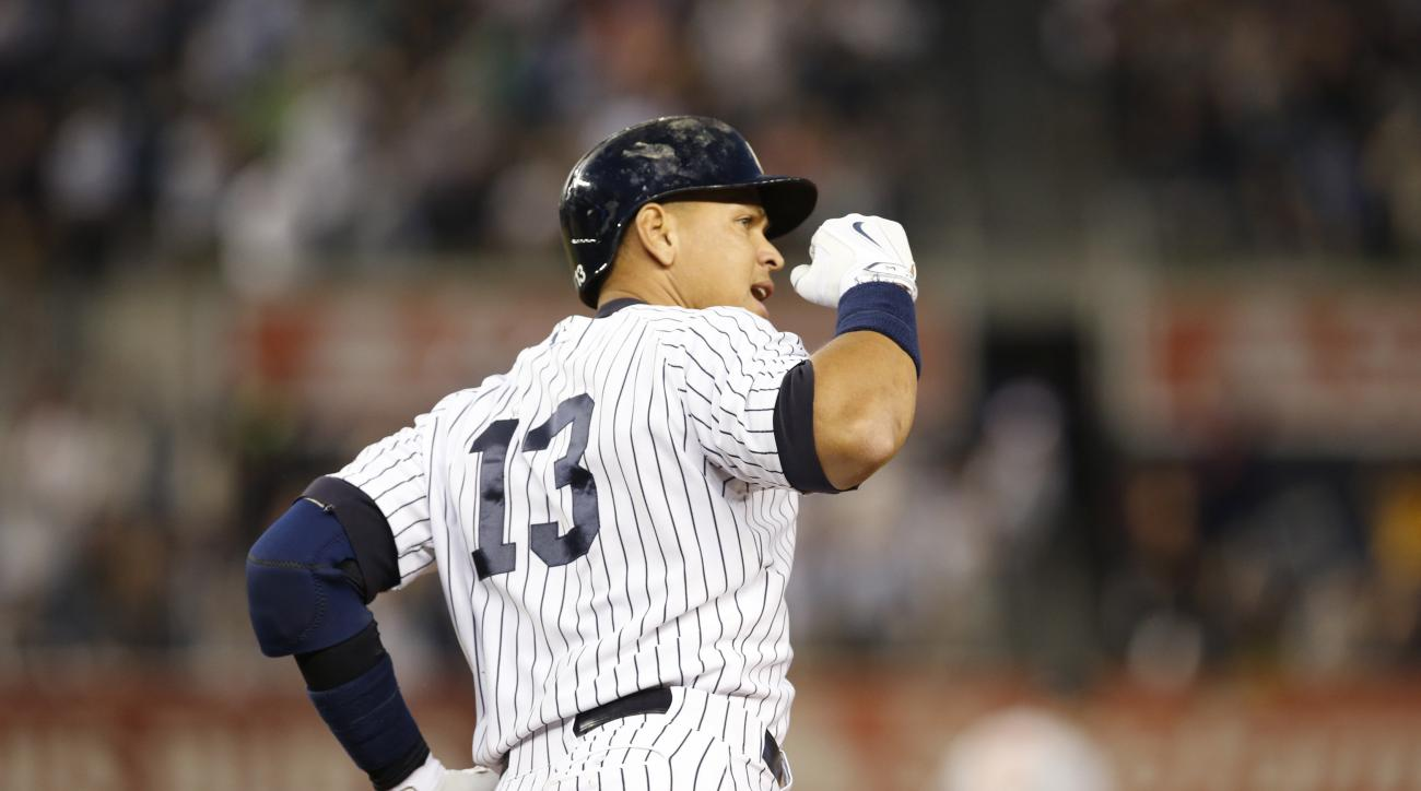 New York Yankees designated hitter Alex Rodriguez pumps his fist as he runs the bases after breaking Willie Mays' record on the all-time home run list after hitting his 661st home run in the third inning of a baseball game against the Baltimore Orioles at
