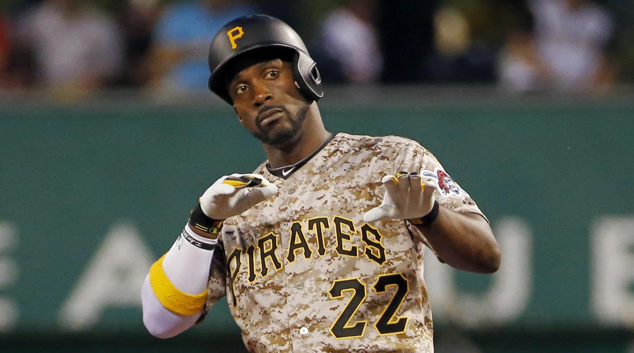 Pittsburgh Pirates' Andrew McCutchen (22) celebrates as he stands on second base after driving in a run with a double off Cincinnati Reds starting pitcher Anthony DeSclafani in the fifth inning of a baseball game in Pittsburgh, Thursday, May 7, 2015. (AP
