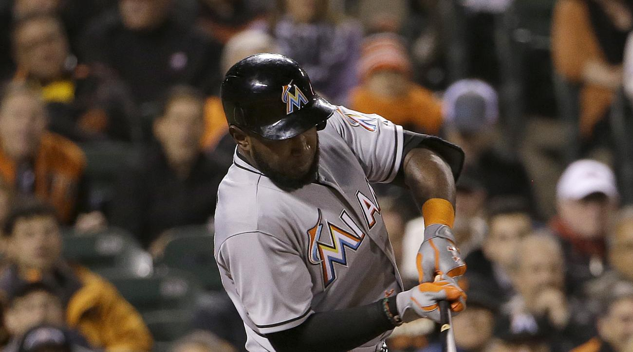 Miami Marlins' Marcell Ozuna hits a two-run home run off of San Francisco Giants pitcher Tim Hudson during the seventh inning of a baseball game Thursday, May 7, 2015, in San Francisco. (AP Photo/Jeff Chiu)