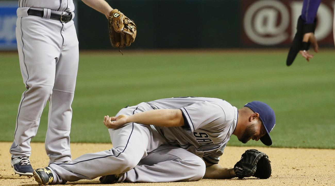 San Diego Padres first baseman Yonder Alonso grimaces on the field during the ninth inning of a baseball game against the Arizona Diamondbacks, Thursday, May 7, 2015, in Phoenix. The Diamondbacks won 11-0. (AP Photo/Matt York)