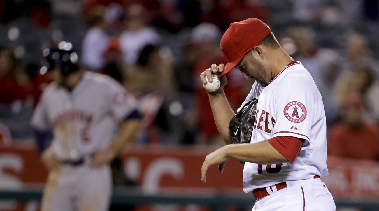 Los Angeles Angels relief pitcher Huston Street reacts after giving up the tying run against the Houston Astros during the ninth inning of a baseball game, Thursday, May 7, 2015, in Anaheim, Calif. (AP Photo/Chris Carlson)