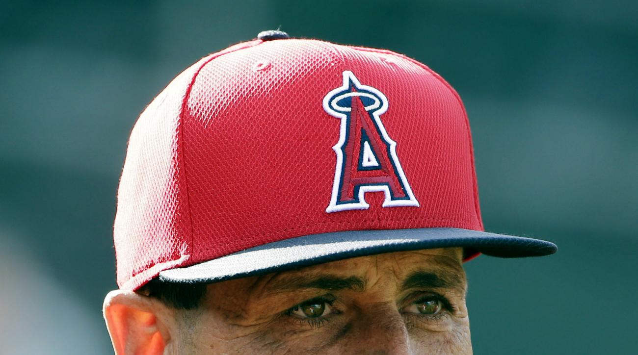 ADVANCE FOR WEEKEND EDITIONS, MAY 8-10 - In this April 28, 2015, photo, Los Angeles Angels bench coach Dino Ebel watches batting practice before a baseball game against the Oakland Athletics in Oakland, Calif. (AP Photo/Marcio Jose Sanchez)