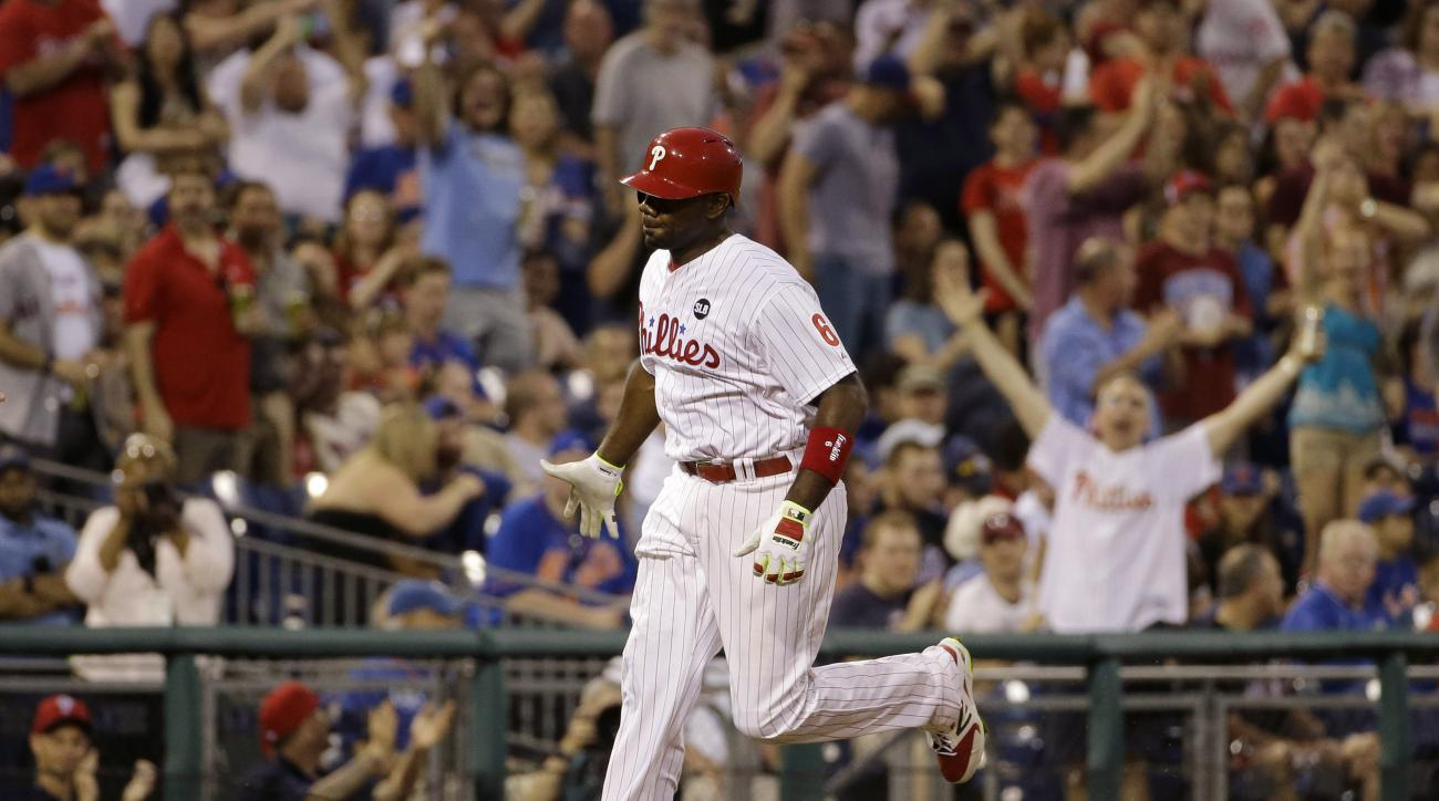 Philadelphia Phillies' Ryan Howard rounds the bases after hitting a home run off New York Mets starting pitcher Matt Harvey during the fourth inning of a baseball game, Friday, May 8, 2015, in Philadelphia. (AP Photo/Matt Slocum)