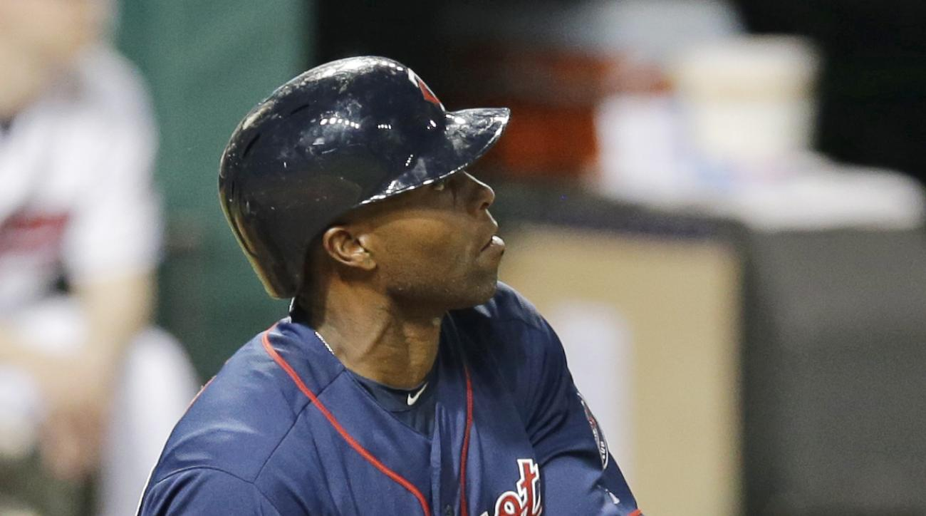 Minnesota Twins' Torii Hunter watches his ball after hitting a three-RBI double off Cleveland Indians relief pitcher Zach McAllister in the sixth inning of a baseball game, Friday, May 8, 2015, in Cleveland. Twins' Kennys Vargas, Jordan Schafer and Ervin