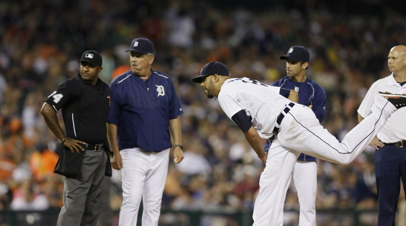 Detroit Tigers starting pitcher David Price throws as home plate umpire Alan Porter, left, Detroit Tigers pitching coach Jeff Jones and manager Brad Ausmus observe during the seventh inning of a baseball game against the Kansas City Royals, Friday, May 8,