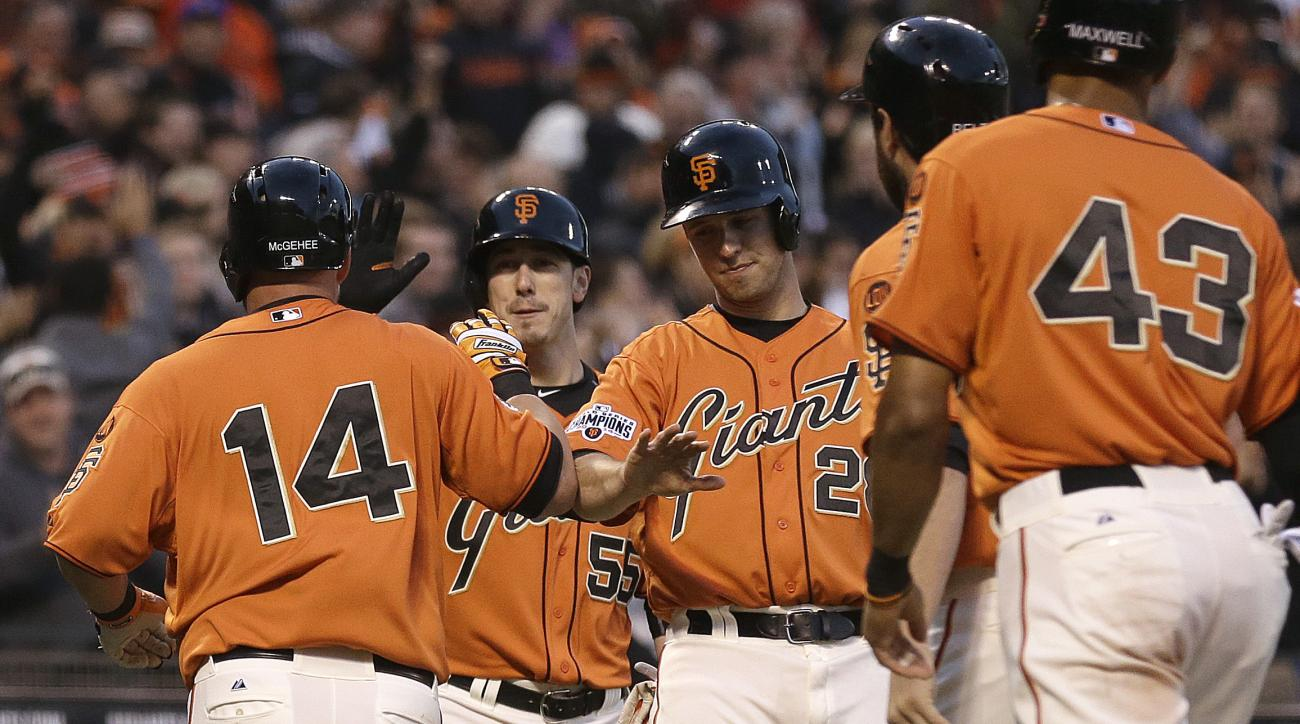 San Francisco Giants' Casey McGehee, left, is congratulated by teammates Tim Lincecum (55), Buster Posey (28) and Justin Maxwell (43) after hitting a grand slam off Miami Marlins' Jarred Cosart in the second inning of a baseball game Friday, May 8, 2015,