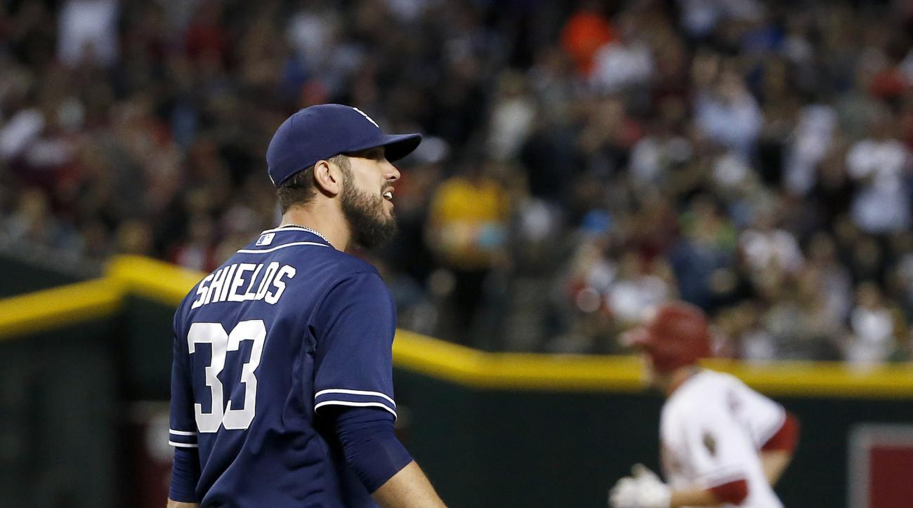 San Diego Padres' James Shields (33) grimaces after giving up a home run to Arizona Diamondbacks' A.J. Pollock, right, during the fifth inning of a baseball game Friday, May 8, 2015, in Phoenix. (AP Photo/Ross D. Franklin)