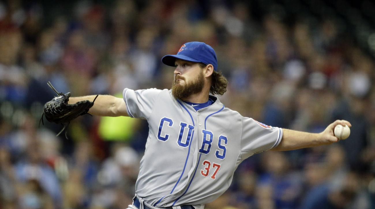 Chicago Cubs starting pitcher Travis Wood throws to the Milwaukee Brewers during the first inning of a baseball game Saturday, May 9, 2015, in Milwaukee. (AP Photo/Jeffrey Phelps)