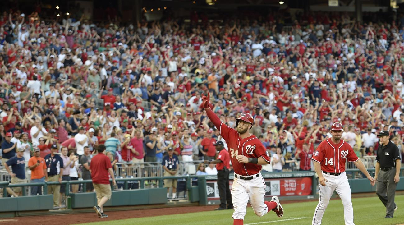 Washington Nationals' Bryce Harper gestures as he heads home after he hit a two-run walk-off home run during the ninth inning of a baseball game against the Atlanta Braves, Saturday, May 9, 2015, in Washington. The Nationals won 8-6. (AP Photo/Nick Wass)