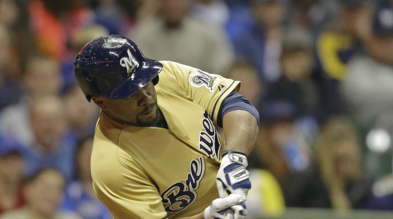 Milwaukee Brewers' Jason Rogers hits a three-run home run against the Chicago Cubs during the fifth inning of a baseball game Saturday, May 9, 2015, in Milwaukee. It was Rogers' first major league home run. (AP Photo/Jeffrey Phelps)