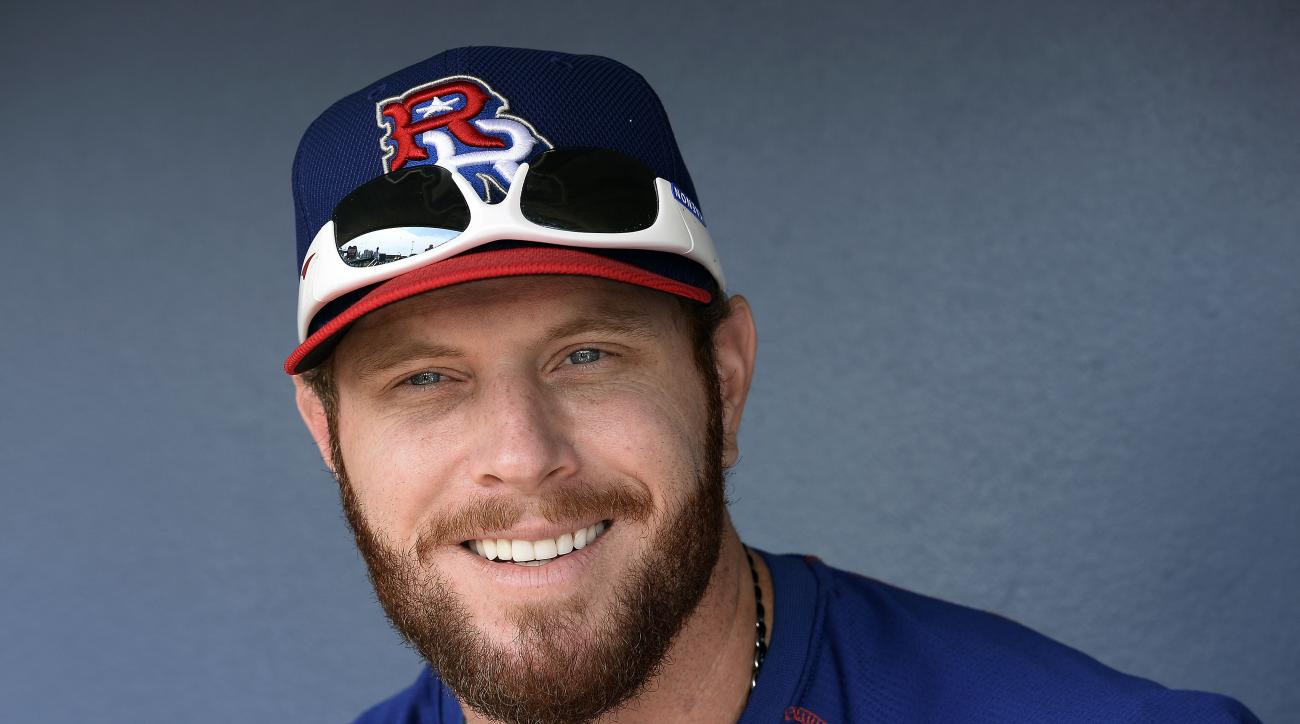 Texas Rangers outfielder Josh Hamilton talks with members of the media before a baseball game against the Nashville Sounds on Sunday, May 10, 2015, in Nashville, Tenn. Hamilton is playing for the Round Rock Express AAA minor league baseball team before re