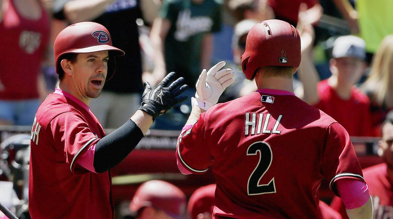 Arizona Diamondbacks' Aaron Hill (2) celebrates his home run against the San Diego Padres with teammate Tuffy Gosewisch, left, during the second inning of a baseball game, Sunday, May 10, 2015, in Phoenix. (AP Photo/Ross D. Franklin)
