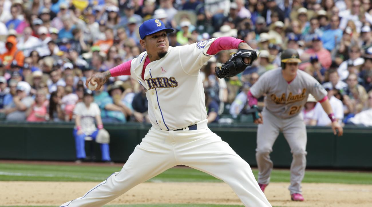 Seattle Mariners starting pitcher Felix Hernandez throws against the Oakland Athletics in the sixth inning of a baseball game, Sunday, May 10, 2015 in Seattle. (AP Photo/Ted S. Warren)