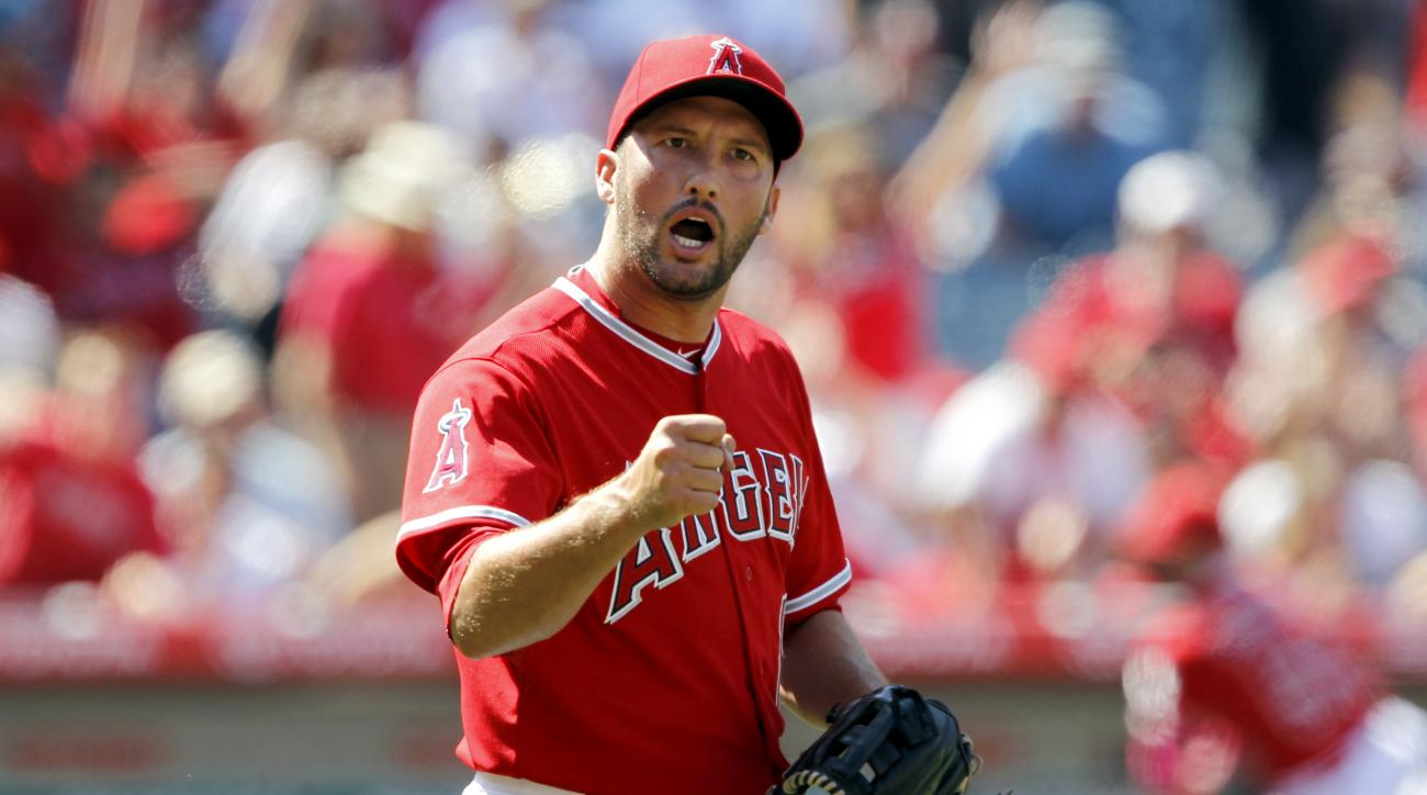 Los Angeles Angels closing pitcher Huston Street reacts after the last out was made during the ninth inning to defeat the Houston Astros 3-1 in a baseball game in Anaheim, Calif., Sunday, May 10, 2015. (AP Photo/Alex Gallardo)