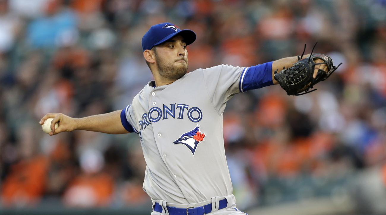 Toronto Blue Jays pitcher Marco Estrada throws to the Baltimore Orioles in the first inning of a baseball game, Monday, May 11, 2015, in Baltimore. (AP Photo/Patrick Semansky)