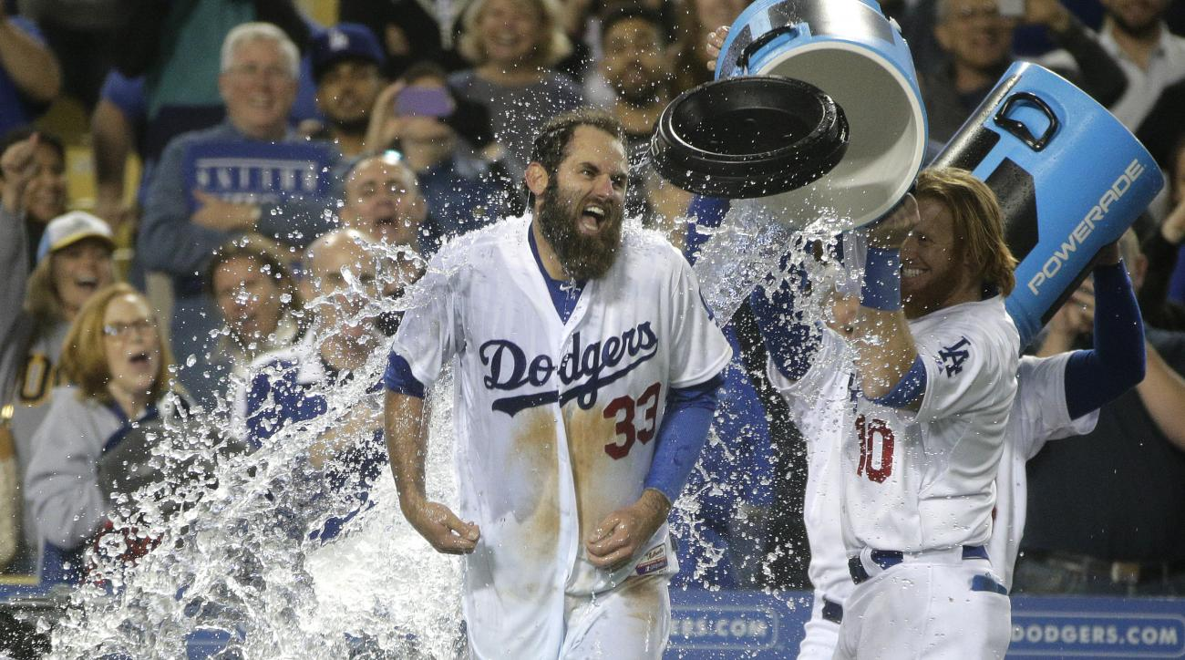 Los Angeles Dodgers' Justin Turner, right, dumps water on Scott Van Slyke as they celebrate a three-run walk off home run by Van Slyke in a baseball game against the Miami Marlins, Monday, May 11, 2015, in Los Angeles. The Dodgers won 5-3. (AP Photo/Jae C