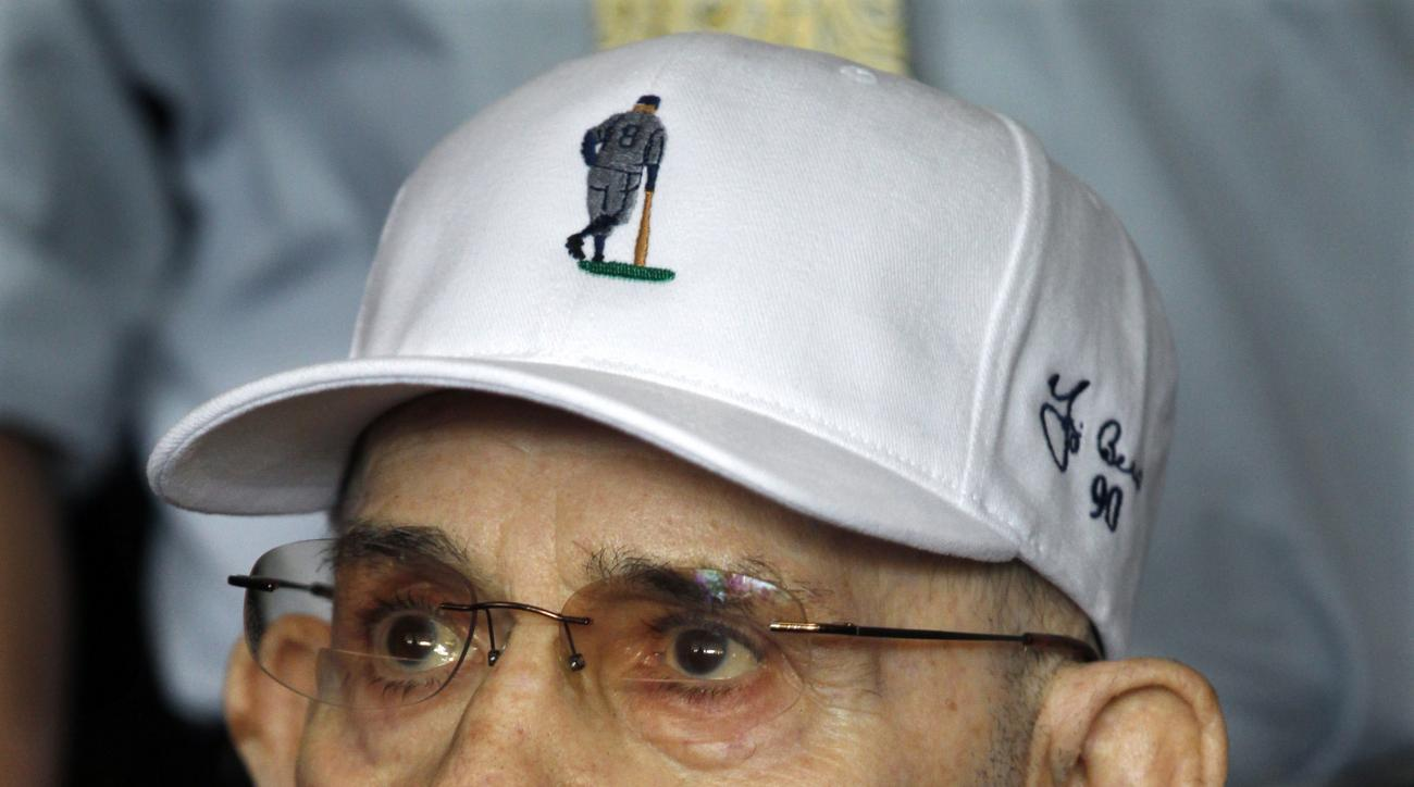 Baseball Hall of Famer Yogi Berra listens to speakers as he marks his 90th birthday at the Yogi Berra Museum & Learning Center on the campus of Montclair State University Tuesday, May 12, 2015, in Montclair, N.J. (AP Photo/Mel Evans)