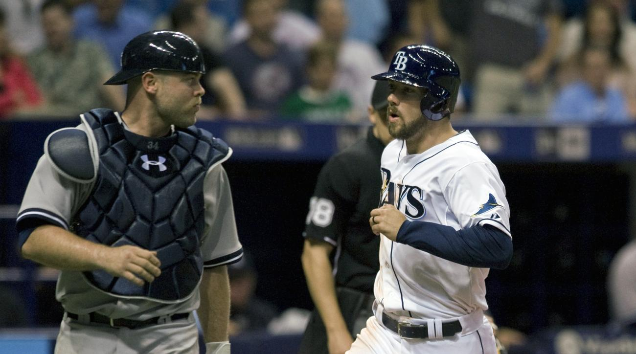 Tampa Bay Rays' Steve Souza Jr. scores past  New York Yankees catcher Brian McCann, left, on a wild pitch from New York reliever Dellin Betances during the eighth inning of a baseball game Tuesday, May 12, 2015, in St. Petersburg, Fla. The Rays beat the Y
