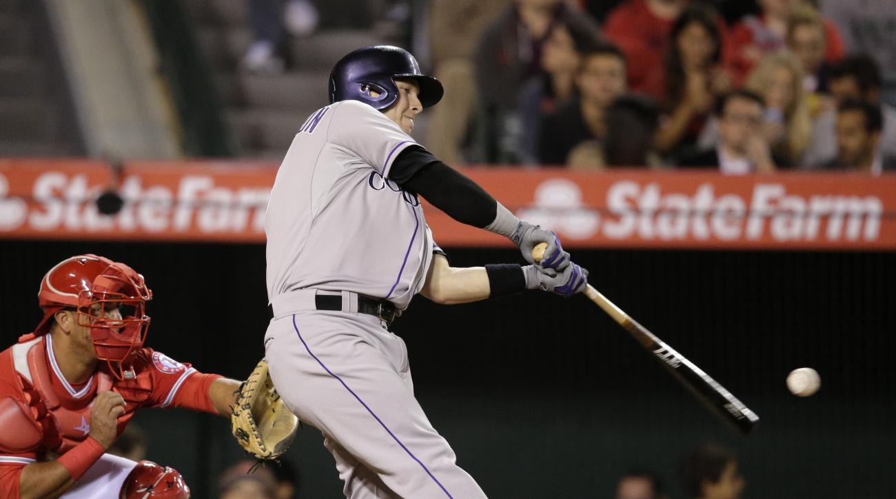 Colorado Rockies' Corey Dickerson hits a RBI double during the fourth inning of a baseball game against the Los Angeles Angels, Tuesday, May 12, 2015, in Anaheim, Calif. (AP Photo/Jae C. Hong)