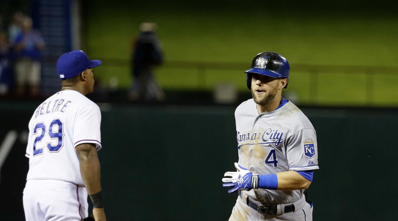 Kansas City Royals Alex Gordon (4) rounds the bases past Texas Rangers third baseman Adrian Beltre (29) after Gordon hit a solo home run during the tenth inning of a baseball in Arlington, Texas, Tuesday, May 12, 2015. (AP Photo/LM Otero)