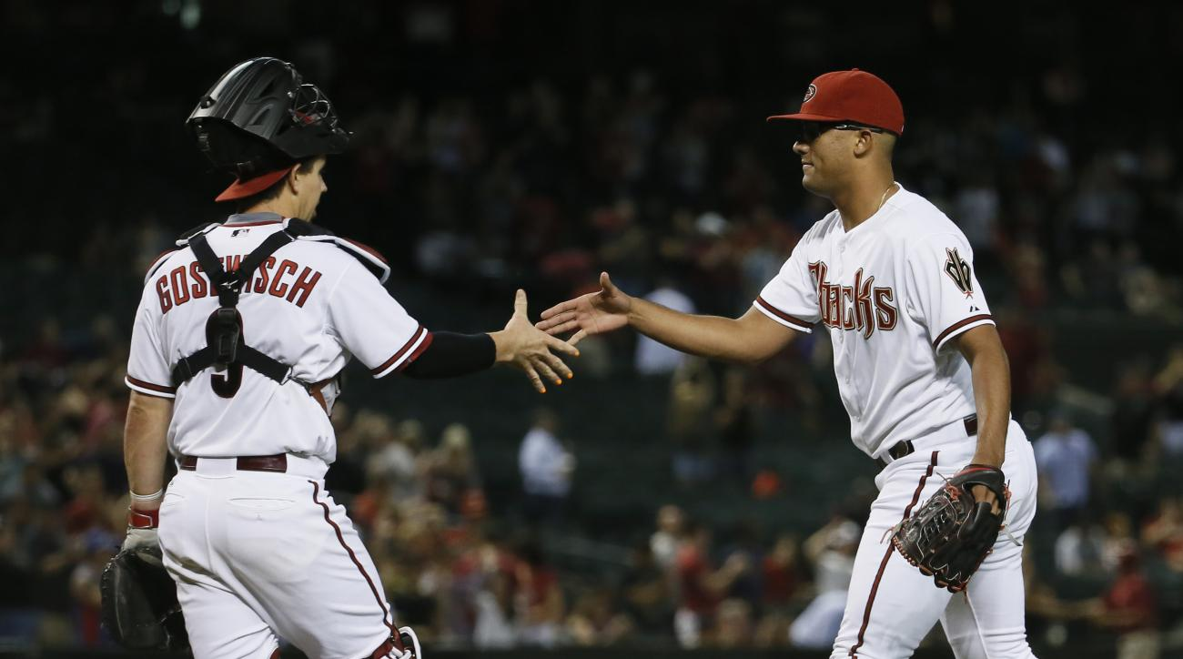 Arizona Diamondbacks pitcher Randall Delgado, right, greets catcher Tuffy Gosewisch after a baseball game against the Washington Nationals, Tuesday, May 12, 2015, in Phoenix. The Diamondbacks won 14-6. (AP Photo/Matt York)