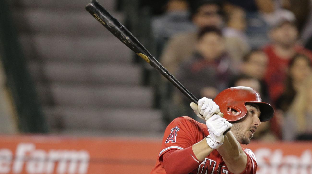 Los Angeles Angels' Matt Joyce hits a two-run double during the eighth inning of a baseball game against the Colorado Rockies, Tuesday, May 12, 2015, in Anaheim, Calif. (AP Photo/Jae C. Hong)