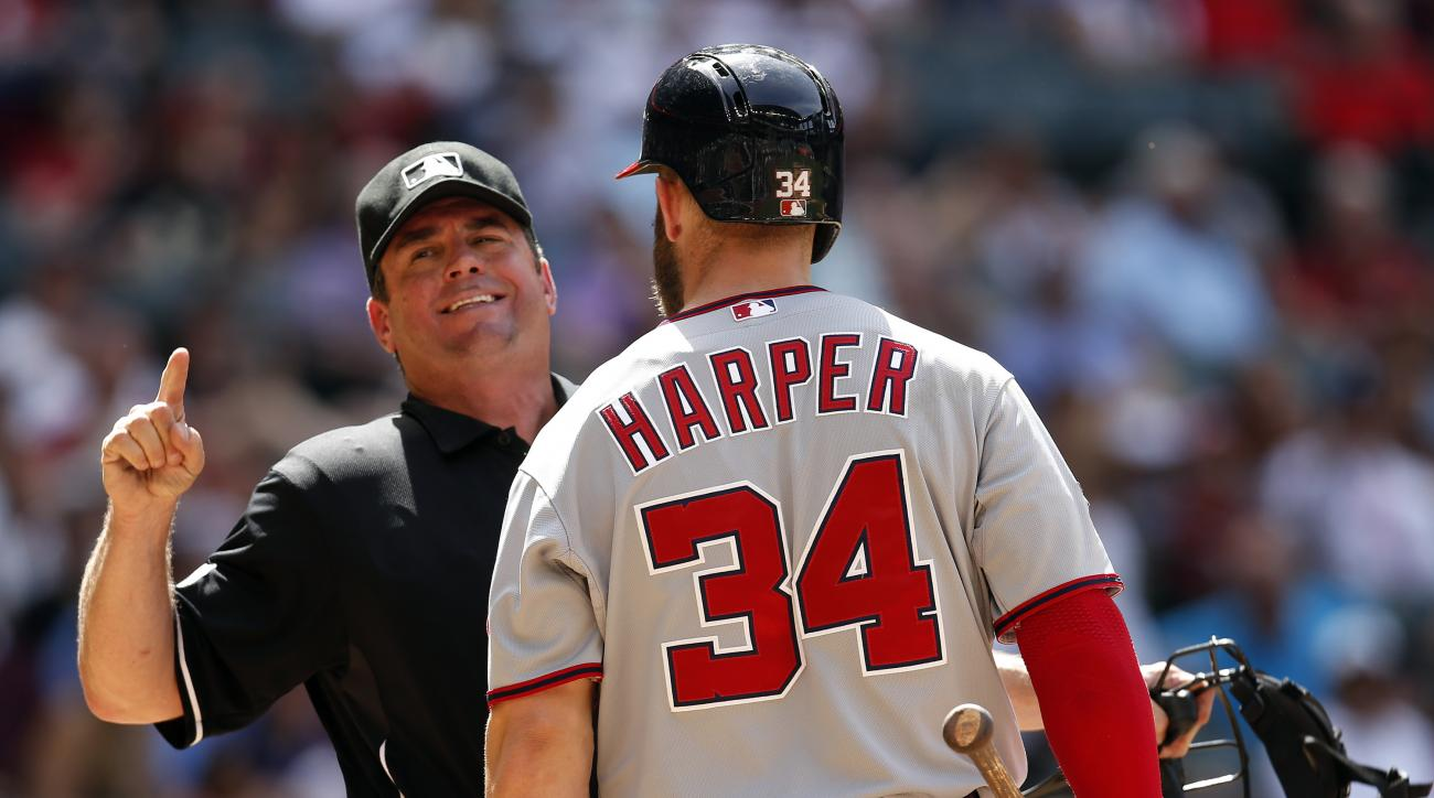 Home plate umpire Rob Drake ejects Washington Nationals' Bryce Harper (34) during the seventh inning of the Nationals' baseball game against the Arizona Diamondbacks, Wednesday, May 13, 2015, in Phoenix. (AP Photo/Rick Scuteri)