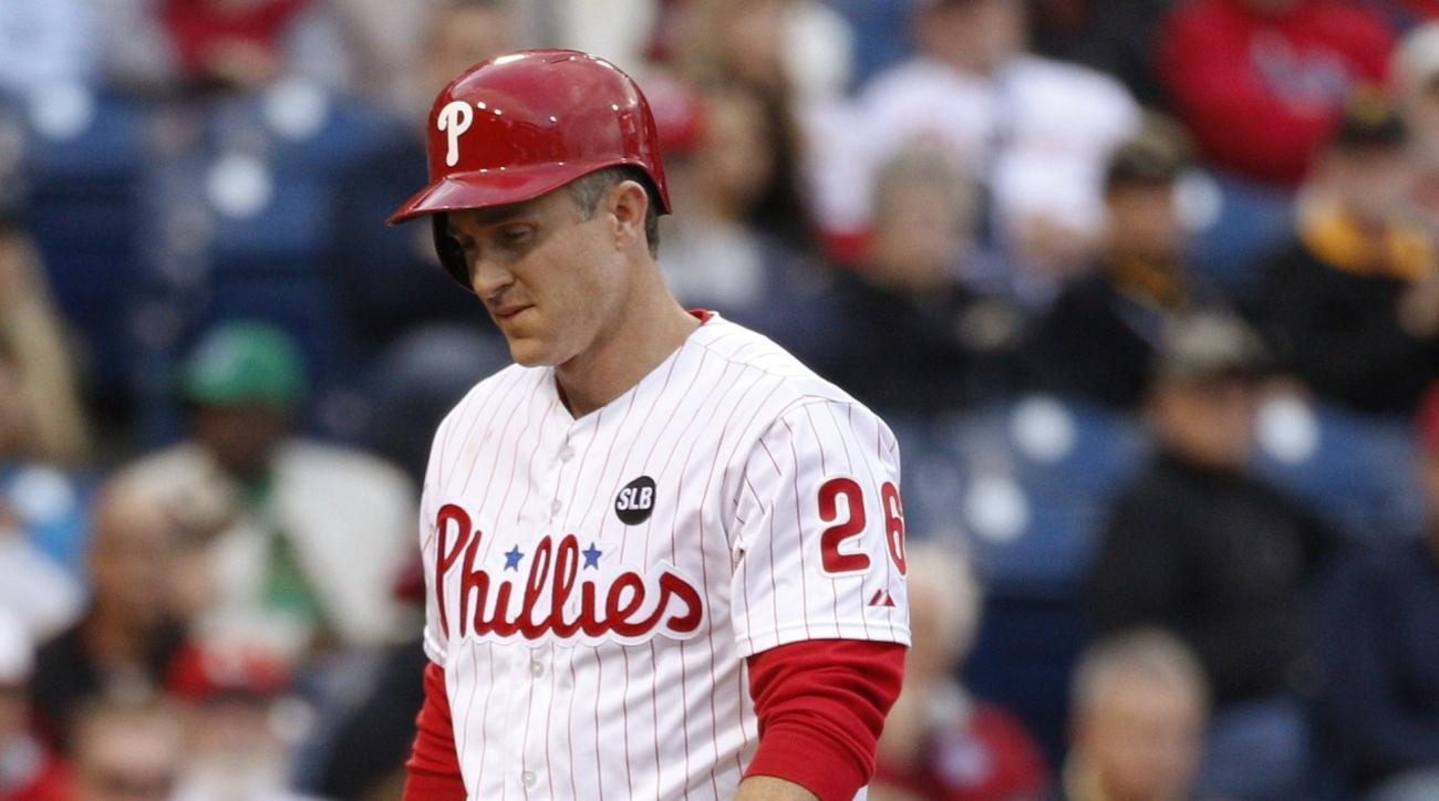 Philadelphia Phillies' Chase Utley heads back to the dugout after striking out during the first inning of a baseball game against the Pittsburgh Pirates, Wednesday, May 13, 2015, in Philadelphia. (AP Photo/Chris Szagola)